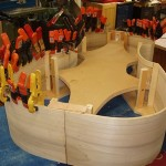After the ribs are on the form, the linings go on. These provide extra gluing surface for the top and back.