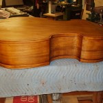 starting to varnish the bass. This is one of the color coats. The client requested an antique finish.